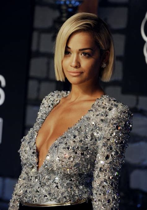 Rita Ora's new tattoo features a topless woman named
