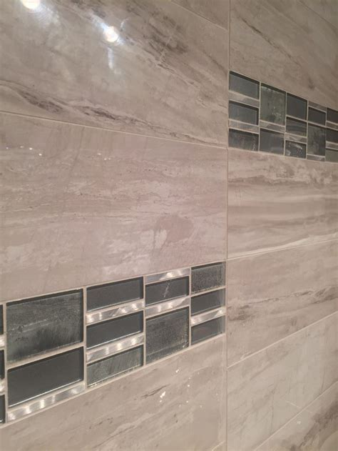 Field Tile: River Marble, Glass/Metal Accent Tile: Tiger
