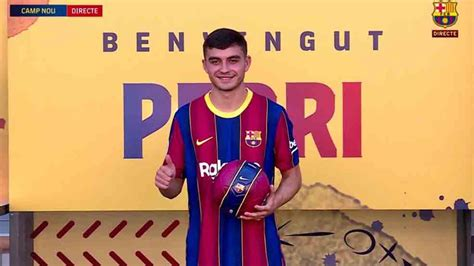 Pedri proudly wears his new Barça shirt after signing a