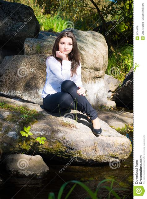 Young Pretty Girl On River Bank Royalty Free Stock Photos
